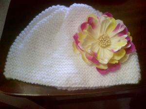 White hat with detachable flower